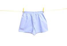Het ondergoed van de mens op waslijn stock foto