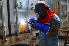 Het onderhoud van de de containerdoos van de arbeiderslasser Royalty-vrije Stock Fotografie