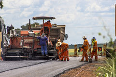 Het onderhoudswerk en bouw van het asfalt Stock Foto's