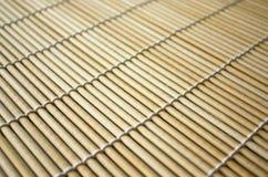 Het onderleggertje van het bamboe voor sushi Stock Afbeeldingen