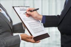 Het ondertekenen van de overeenkomst stock foto