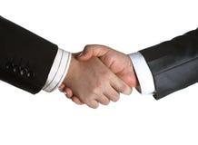 Het ondertekenen van de overeenkomst en een handdruk stock foto's