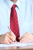 Het ondertekenen van documenten stock fotografie