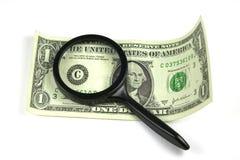 Het onderzoeken van de dollar stock foto
