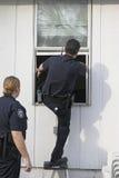 Het onderzoeken van de politie inbraak Royalty-vrije Stock Foto