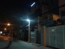 Het onduidelijke beeld van de de nachtfiets van Vietnam van de wegstraat Royalty-vrije Stock Foto's