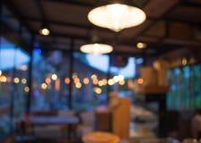 Het onduidelijke beeldachtergrond van de koffiewinkel met bokeh Stock Fotografie