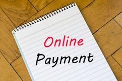 Het online concept van de betalingstekst op notitieboekje Royalty-vrije Stock Fotografie