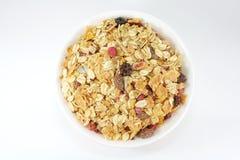 Het Ontbijt van Muesli in een Kom of een Kop Stock Foto's