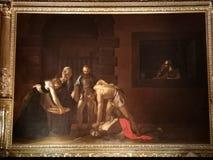 Het onthoofden van Saint John Doopsgezind door Caravaggio stock afbeeldingen
