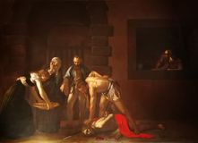Het onthoofden van Saint John Doopsgezind door Caravaggio stock foto's