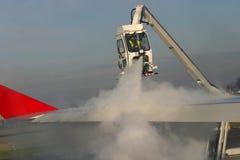 Het ontijzelen van het vliegtuig Stock Foto
