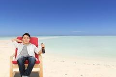 Het ontspannen op Strand Stock Foto