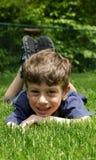 Het Ontspannen van het kind stock foto
