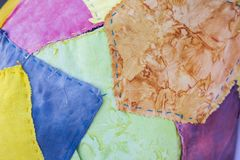 Het ontwerpachtergrond van de close-up colorfful stof stock foto's