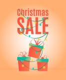 Het ontwerpmalplaatje van de Kerstmisverkoop, banner, met giftdozen en lichtgevende slinger Stock Foto's