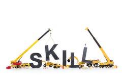 Het ontwikkelen van vaardigheden: Machines die vaardigheid-woord bouwen. Royalty-vrije Stock Fotografie
