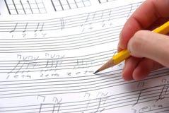 Het onzorgvuldige muziek schrijven. Stock Foto's