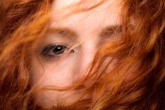 Het Oog van de roodharigevrouw stock foto's