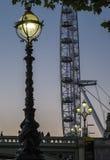 Het oog van Londen en de brug van Westminster Stock Fotografie