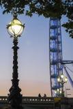 Het oog van Londen en de brug van Westminster Royalty-vrije Stock Afbeelding