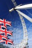 Het Oog van Londen met vlaggen, Londen, het UK Stock Foto