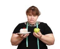 Het op dieet zijn te zware vrouwenkeus Stock Foto's