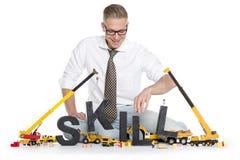 Het ontwikkelen van vaardigheden: De bouw van de zakenman vaardigheid-woord. royalty-vrije stock afbeeldingen