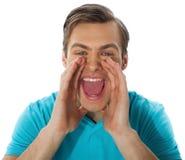 Het opwindende jonge knappe mens schreeuwen Royalty-vrije Stock Afbeeldingen