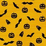 Het oranje feestelijke naadloze patroon van Halloween Eindeloze achtergrond met pompoenen, schedels, knuppels, spinnen, spoken, b Stock Foto