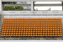 Het oranje lege voetbal van de stadionsport/voetbalzetel Stock Foto