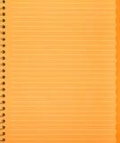 het oranje stuk van document van het notitieboekje met de lente Royalty-vrije Stock Afbeeldingen