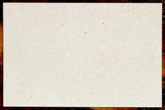 Het organische lichte roomdocument in gevormd kader, rekupereerbaar materiaal, heeft kleine opneming van cellulose Spatie voor uw stock fotografie