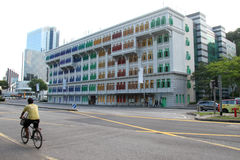 Het oriëntatiepunt van Singapore met mens het cirkelen Royalty-vrije Stock Foto