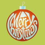 Het ornament van de Kerstmisbal met de woorden Stock Fotografie