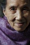 Het oude close-up van het vrouwenportret royalty-vrije stock foto's