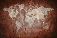 Het oude document van Grunge met wereldkaart Royalty-vrije Stock Foto