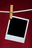 Het oude fotoframe maakt aan kabel vast Royalty-vrije Stock Afbeeldingen