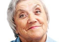 Het oude gezicht van de vrouwenglimlach grootmoeder stock afbeeldingen