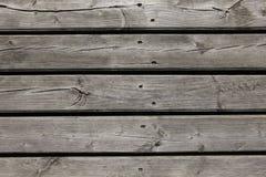 Het oude grijze houten planking stock foto