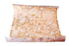 Het oude pakpapierbroodje op witte dichte omhooggaand als achtergrond, ontwerp van het rol het antieke document, kopieert ruimte, stock fotografie