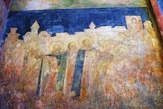 Het oude schilderen op de kerkvoorzijde van Arkhangel. Stock Foto