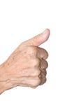 Het oude vrouwenhand tonen beduimelt omhoog Royalty-vrije Stock Fotografie