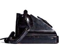 Het oude zwarte geïsoleerde zijaanzicht van de eboniettelefoon Royalty-vrije Stock Foto's