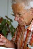Het oudere mens schilderen Royalty-vrije Stock Foto's
