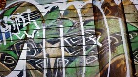 Het overgaan van Graffiti op Rusty Metal Surface stock videobeelden