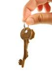 Het overhandigen sleutels Stock Fotografie