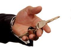 Het overhandigen van de sleutels stock foto's