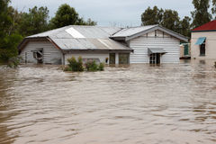 Het overstroomde Huis van de Verzekering Stock Fotografie