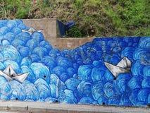 Het overzees door straatkunstenaar die kan wordt geschilderd zo mooi zijn zoals echte  stock afbeeldingen